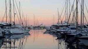 Med season blog article superyachts in a marina at sunset